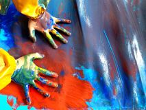 Closeup of children hands painting during a school activity - learning by doing, education and art, art therapy concept royalty free stock images