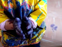 Closeup of children hands painting during a school activity - learning by doing, education and art, art therapy concept.  stock photography