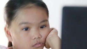 Closeup of children looking computer stock footage