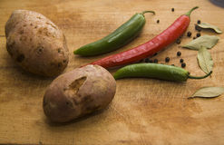 Closeup of Chili peppers and american potato Royalty Free Stock Photos