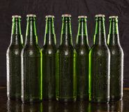 Chilled beer, alcohol, background, bar, beer, beverage, black, brew, Summer party. Closeup of Chilled beer. Brewed beer in bottles on wooden table on black royalty free stock images