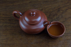 Closeup china tea pot. With cup of hot tea Royalty Free Stock Image