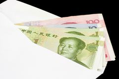 Closeup of Chinese currency. In envelope on black background Stock Photos