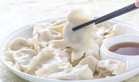 Closeup of Chinese food JIAOZI, Dumpling with chopsticks. Stock Image