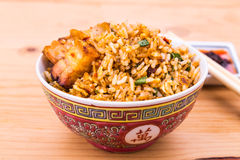Closeup Chinese spicy fried rice with roast pork in bowl Royalty Free Stock Photos