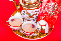 Closeup on Chinese tea set with envelope bearing the word double happiness Royalty Free Stock Images