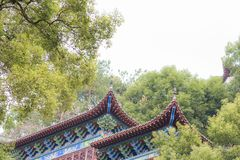 Closeup of Chinese temple eaves In the sky. Temple eaves of Nanchang monastery, part of complex of Stock Photo