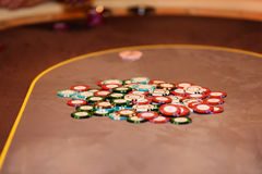 Closeup of chips on poker table, selective focus. Closeup of chips on poker table Stock Photography