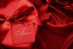 Closeup chocolate box with gift card on satin Royalty Free Stock Photos