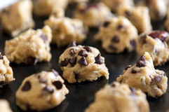 Closeup of chocolate chip cookies dough on baking tray ready for baking Stock Photo