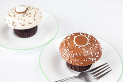 Closeup chocolate cupcake with white sprinkle and fork Royalty Free Stock Photos