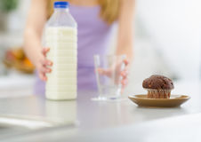 Closeup on chocolate muffin and girl in background Royalty Free Stock Photography