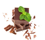 Closeup  of chocolate parts and mint leaves Stock Photo
