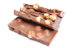 Closeup of chocolate pieces on white background Royalty Free Stock Photo