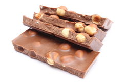 Closeup of chocolate pieces on white background Stock Photography