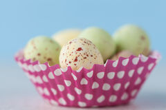Closeup of chocolate speckled Easter eggs in cupcake liner Royalty Free Stock Photos