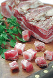 Closeup chopped bacon and parsley Stock Photography