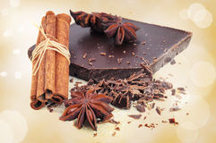 Closeup of chopped chocolate, cinnamon and anise Stock Images