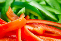 Closeup of chopped red and green peppers Royalty Free Stock Images