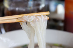 Closeup chopstick clamp the vietnamese noodle Royalty Free Stock Photography