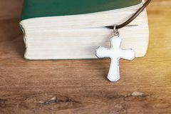 Closeup christian cross and bible on old wooden table with sunli. Ght. christian concept Jesus is the light of the world, Copy space for design Royalty Free Stock Photos