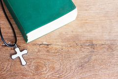 Closeup christian cross and bible on old wooden table with sunli. Ght. christian concept Jesus is the light of the world, Copy space for design Stock Images