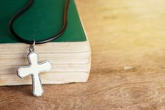 Closeup christian cross and bible on old wooden table with sunli. Ght. christian concept Jesus is the light of the world, Copy space for design Stock Photography