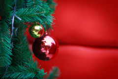 Closeup Christmas ball on red background from Christmas tree Royalty Free Stock Photos