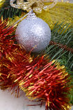 Closeup of Christmas balls and green fir tree branch, new year invitation card Stock Photography