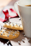 Closeup of christmas biscuits and a mug of coffee Stock Photography