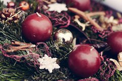 Closeup on Christmas candles on pine garland decoration Stock Image