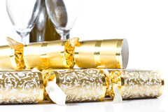 Closeup of christmas crackers and Champagne bottle Stock Photography