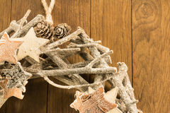 Closeup of christmas decoration with twigs, brown pine cone and Royalty Free Stock Photos