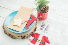 Closeup of Christmas dinner table setting on white background Royalty Free Stock Photos