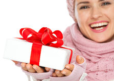 Closeup on Christmas gift box in hand of woman Stock Photography