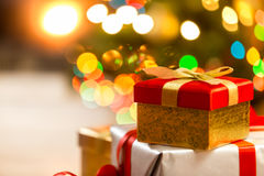 Closeup of Christmas gift boxes on the background of lights Royalty Free Stock Image