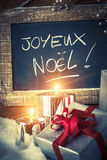 Closeup of Christmas gifts with candles Royalty Free Stock Image