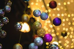 Closeup of Christmas holiday tree decorations with bokeh on background.  Royalty Free Stock Photos