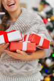 Closeup on Christmas present boxes holding by girl Royalty Free Stock Photography