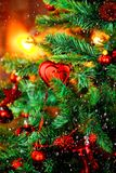 Closeup of Christmas-tree background. Christmas tree background and Christmas decorations with snow, blurred, sparking, glowing. royalty free stock images