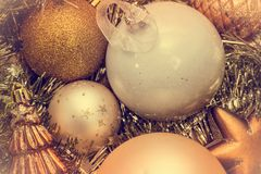 Closeup of Christmas-tree decorations, gold christmas background sparkles stock image