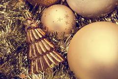 Closeup of Christmas-tree decorations, gold christmas background sparkles royalty free stock photos