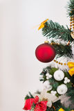Closeup on Christmas tree with red Christmas ball Royalty Free Stock Images