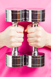 Closeup of chromed dumbbells or weights in female hand Royalty Free Stock Photography