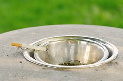 Closeup of cigarette on ashtray Royalty Free Stock Photos