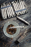 Closeup of cigarettes, ashtray and lighter Royalty Free Stock Photo