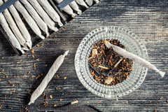 Closeup of cigarettes and ashtray Stock Image