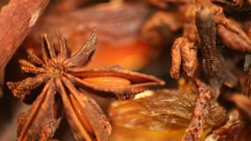 Closeup of cinnamon stick and aniseed rotating, sweet and savoury food additive stock footage