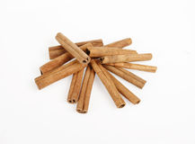 Closeup of cinnamon sticks. On white background royalty free stock photos