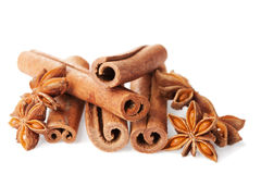 Closeup of cinnamon sticks and anise star on white Stock Images